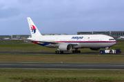 Boeing 777-2H6/ER (9M-MRF)