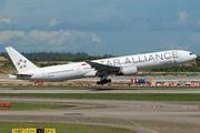 Boeing 777-312 (9V-SYL)